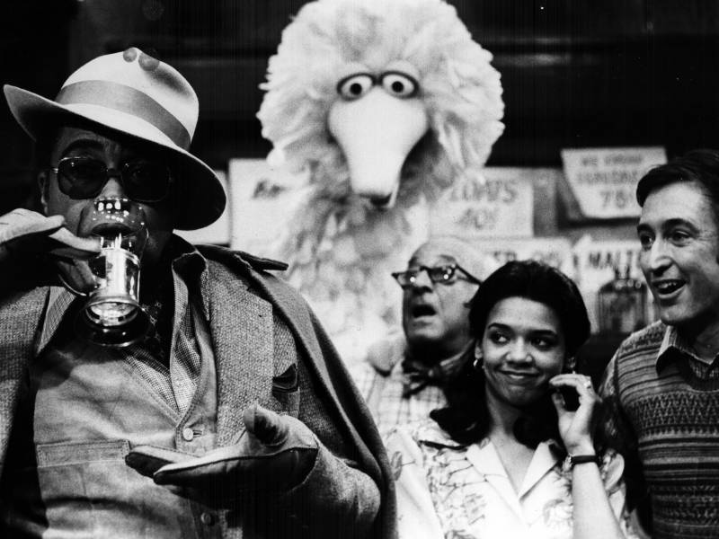James Earl Jones guest stars on 'Sesame Street' with regular cast members Big Bird, Mr. Hooper (played by actor Will Lee) and Maria (actor Sonia Manzano).