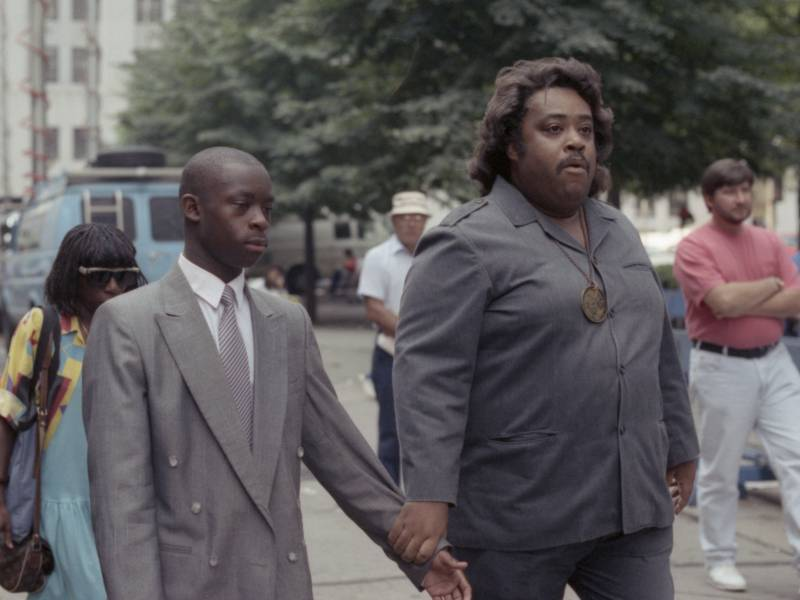 Salaam appears with Rev. Al Sharpton during his 1990 trial.
