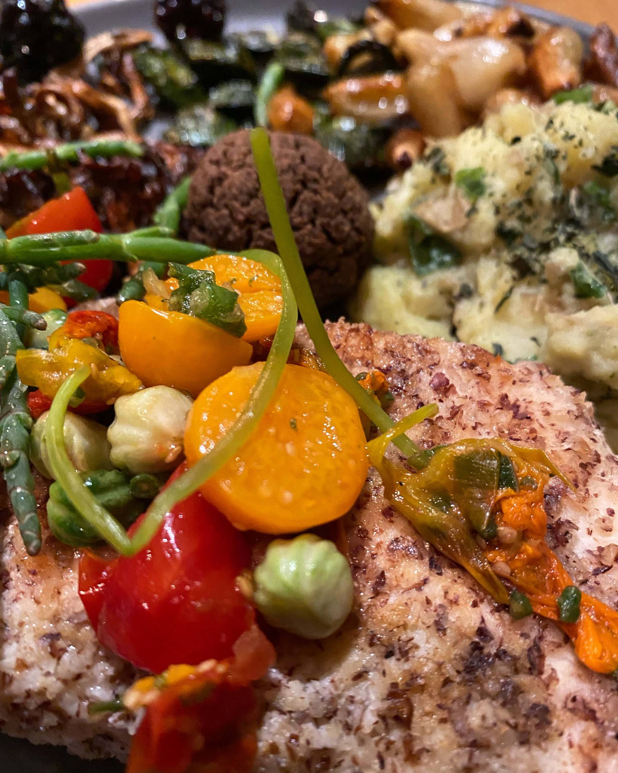 Pan-fried halibut with a hazelnut flour curst and a colorful gooseberry salsa