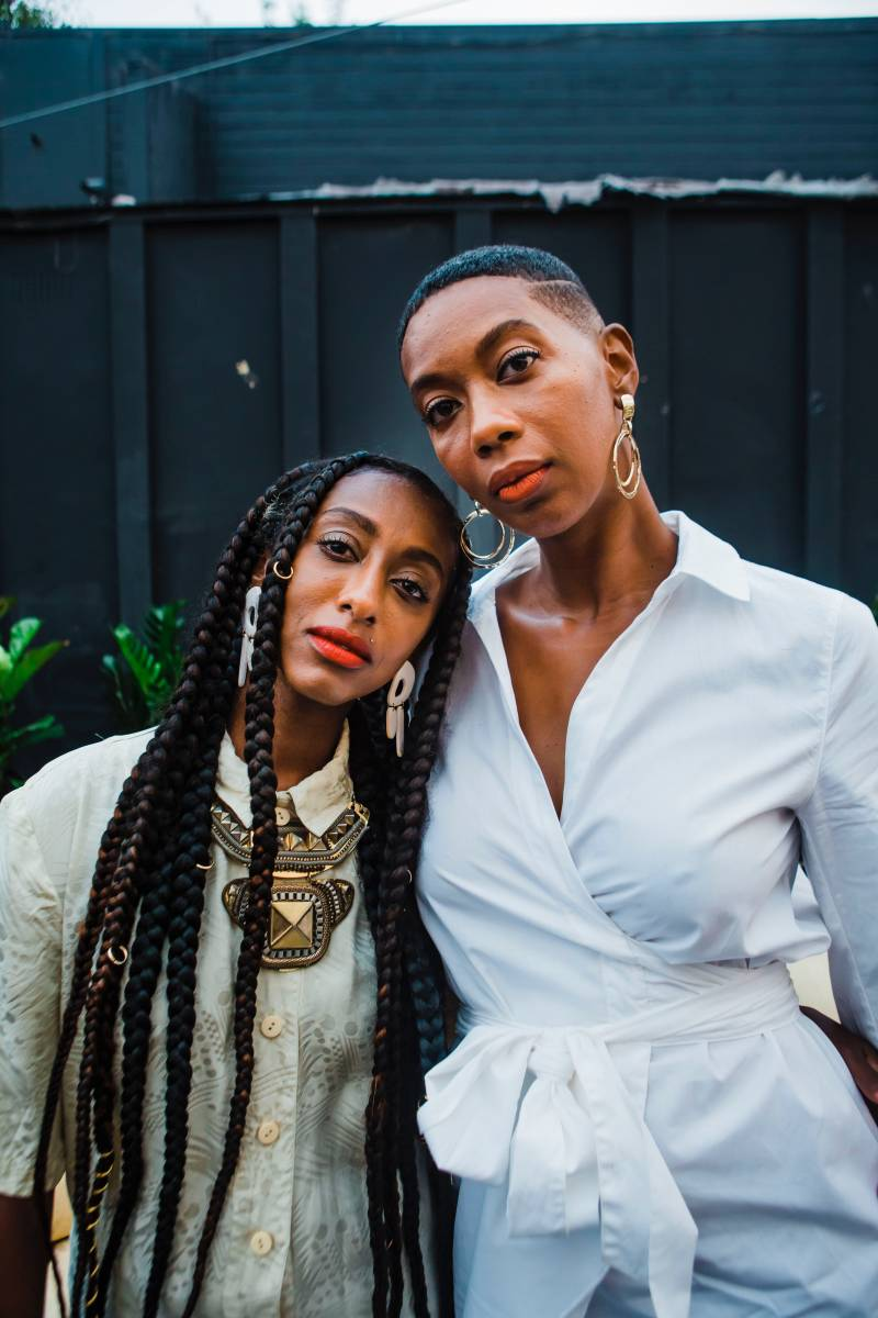 """Co-founders of Blk Gilrs Green House, Kalkidan (""""Kalu"""") Gebreyohannes and J'Maica Roxanne, stand next to each other as they pose for a photo."""