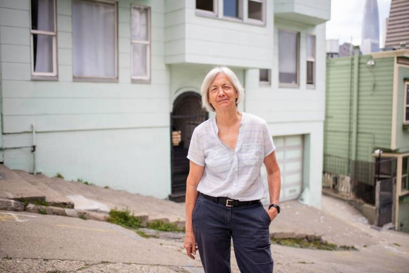 Lynn Painter, one of the hosts in the Host Homes program, stands in front of her house in San Francisco.