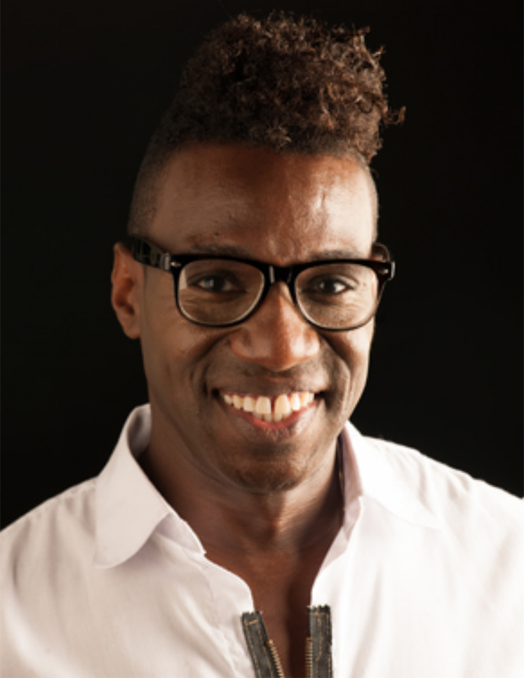 Headshot of Karter Louis smiling in glasses and a white collared shirt.