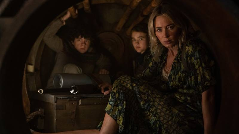 Marcus (Noah Jupe), Regan (Millicent Simmonds) and Evelyn (Emily Blunt) huddle together in an enclosed space in 'A Quiet Place Part II.'