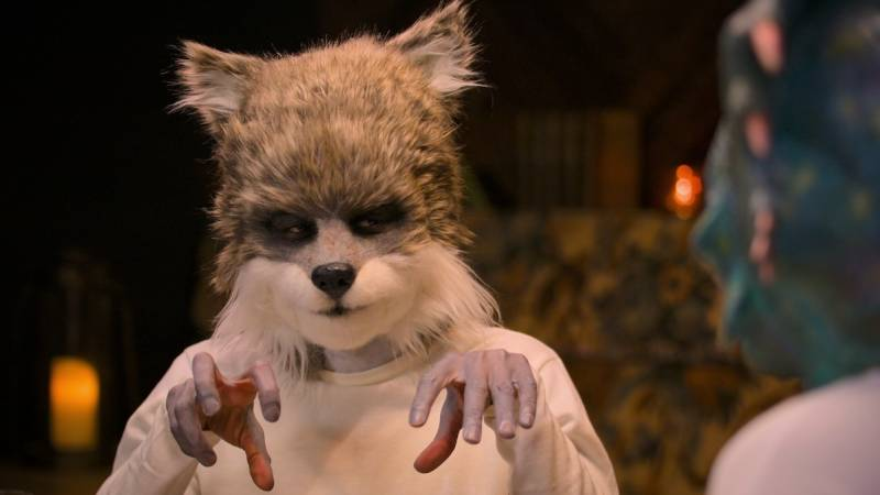 A man wearing a cute and furry wolf's head. He is one of the participants on the coming Netflix series 'Sexy Beasts.' We're as confused as you are.