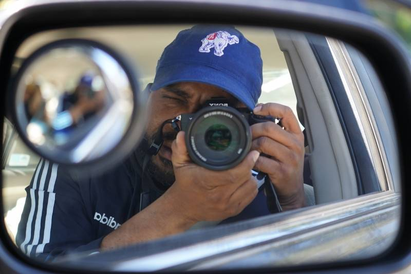 The author, Pendarvis Harshaw, in the rear-view mirror.