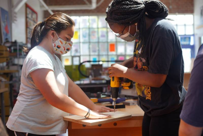 A bookshelf in the making! Two young folks put their tools to use as they work on their next piece at Girls Garage.