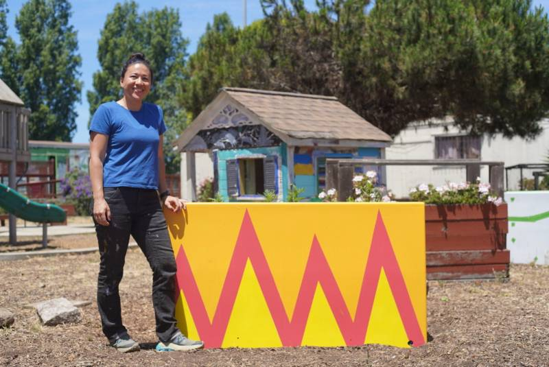Emily Pilloton-Lam stands next to a flower box made by Girls Garage students and donated to the BOSS organization.
