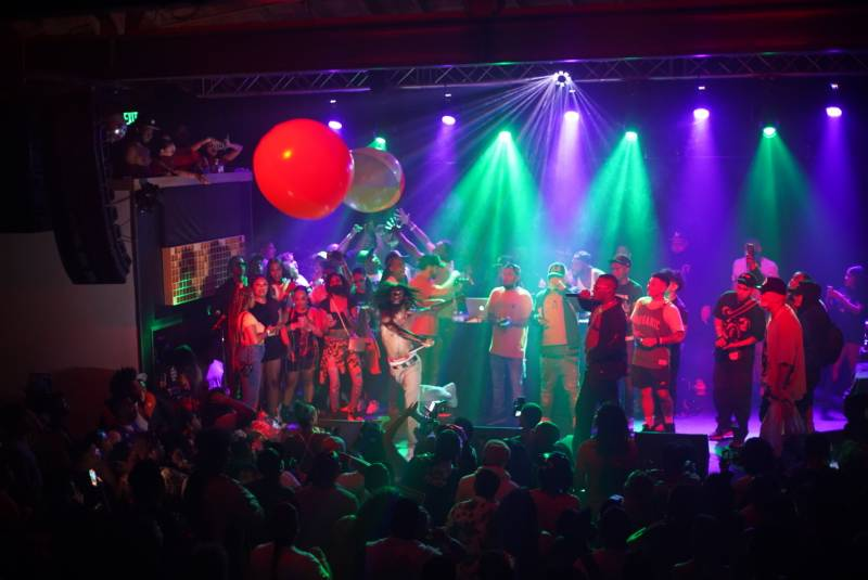 10 Piece Tone punches an oversized beach ball in the air while performing at Cornerstone in Berkeley.