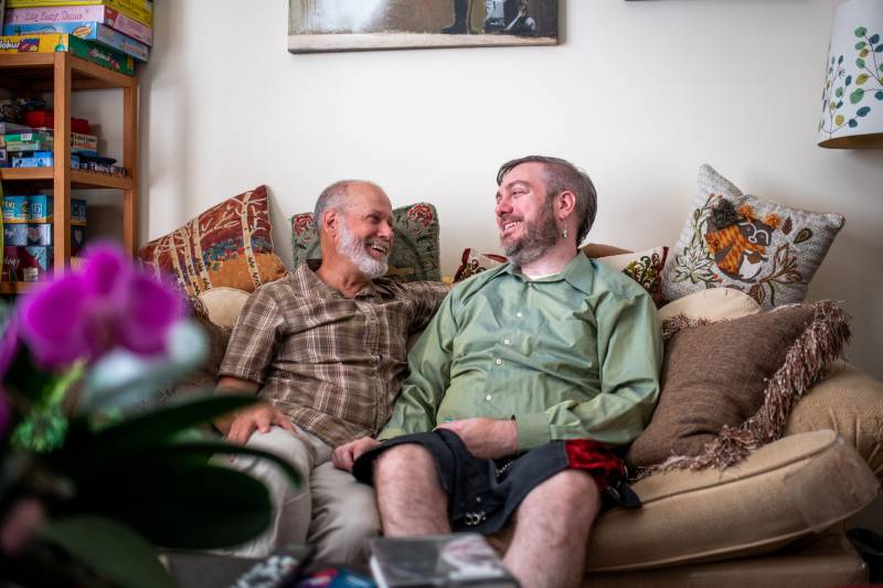 Erik Green (left) and Ron Frost share a moment on the couch.