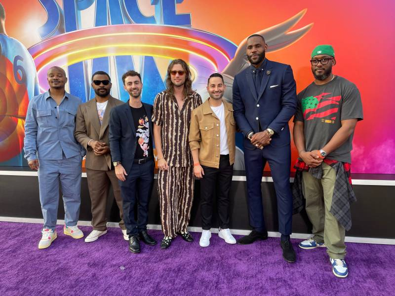 Actors, rappers and producers pose for a photo on the red carpet at the premiere of 'Space Jam: A New Legacy.'