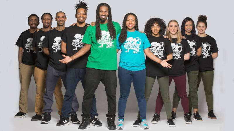 Ten members of Just Sole! Street Dance Theater face the camera and smile.