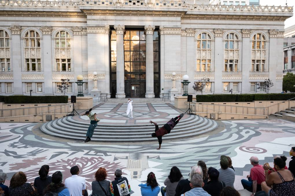 Macio Payomo, Sarah Crowell, and Rashidi Omari perform outside Oakland's City Hall for the grand finale of 'SPACES: Oakland.'