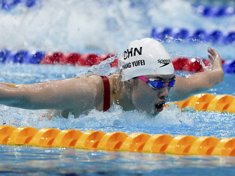 Zhang Yufei of China swims toward an Olympic record and gold medal in the women's 200-meter butterfly final at the Tokyo Olympics.