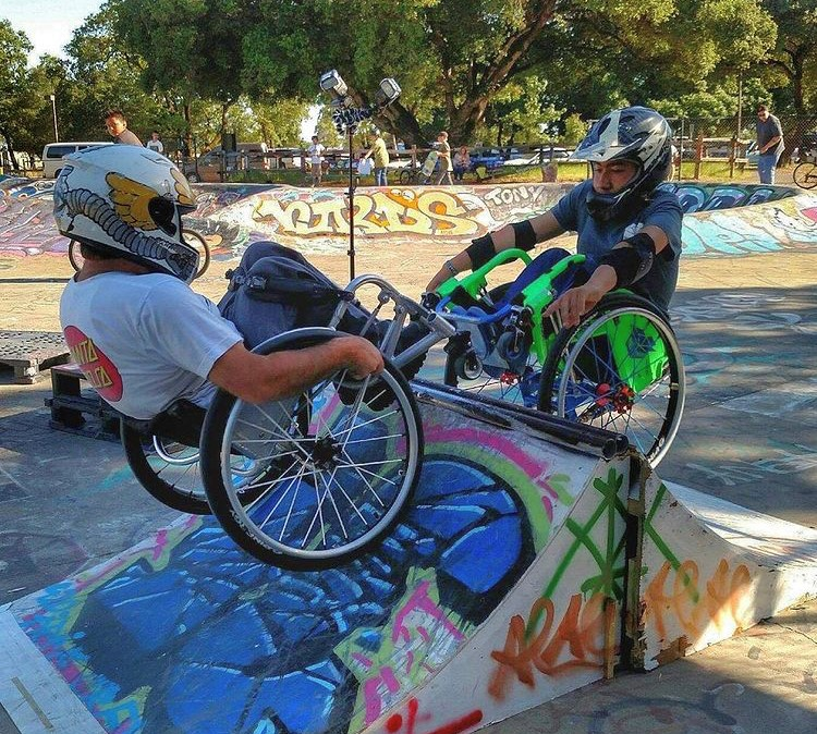 Randy Harlan and Garnett Silver-Hall ride toward each other on different sides of the same ramp in a skatepark.
