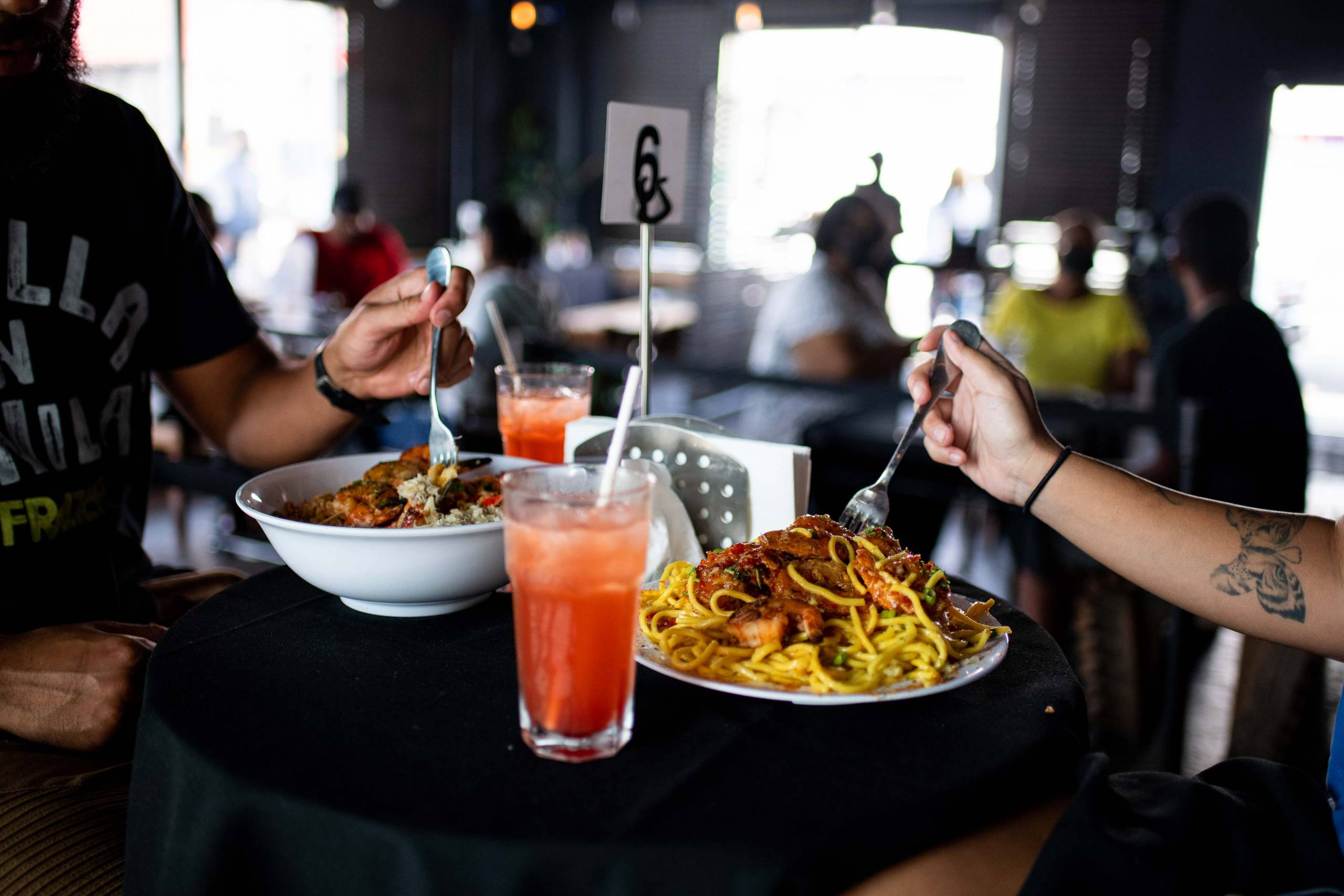 Customers enjoy cocktails and heaping seafood platters at the Chef Smelly's pop-up.