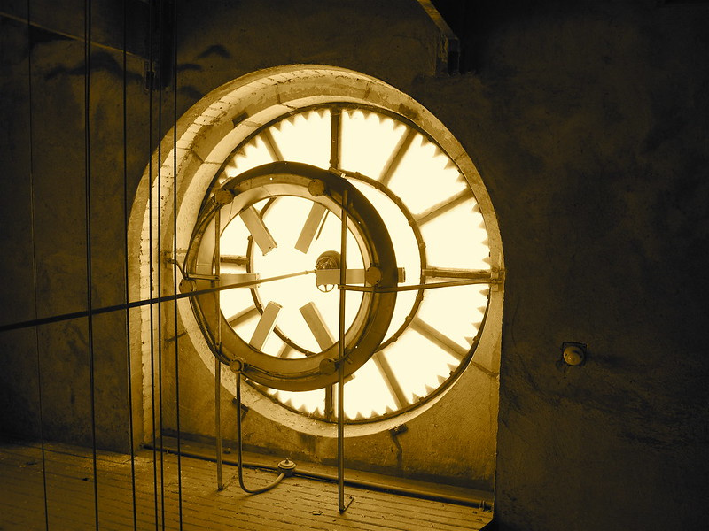 View from inside the tower out thorough the backlit clock face.