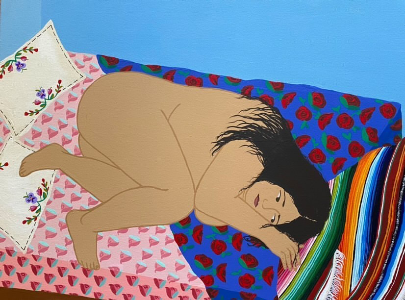 Nude woman lays in fetal position on a bed.