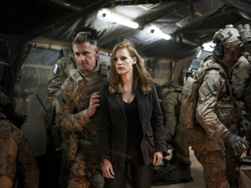 Stationed at a covert base overseas, Maya (Jessica Chastain) is a member of the elite team of spies and military operatives (Christopher Stanley, left, and Alex Corbet Burcher, right) who devote themselves to finding Osama bin Laden in 'Zero Dark Thirty.'