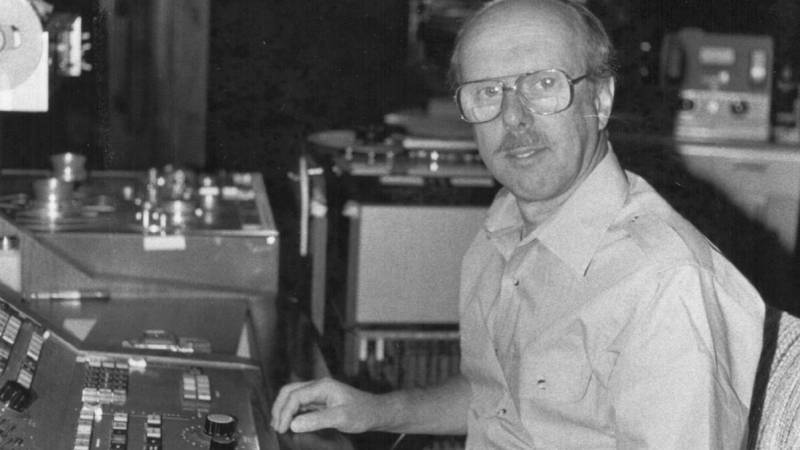 George Horn sitting at his studio controls