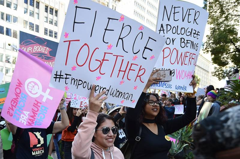 Protestors march to City Hall during the Third Annual Women's March in downtown LA, January 2019.