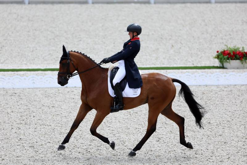 Britain's Tom McEwen riding Toledo de Kerser in the individual dressage competition at the Tokyo Olympics, July 31, 2021.
