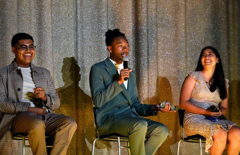 Dwayne Davis holds the microphone as he sits on a panel between Denilson Garibo and Jessica Ramos, discussing the film Homeroom.