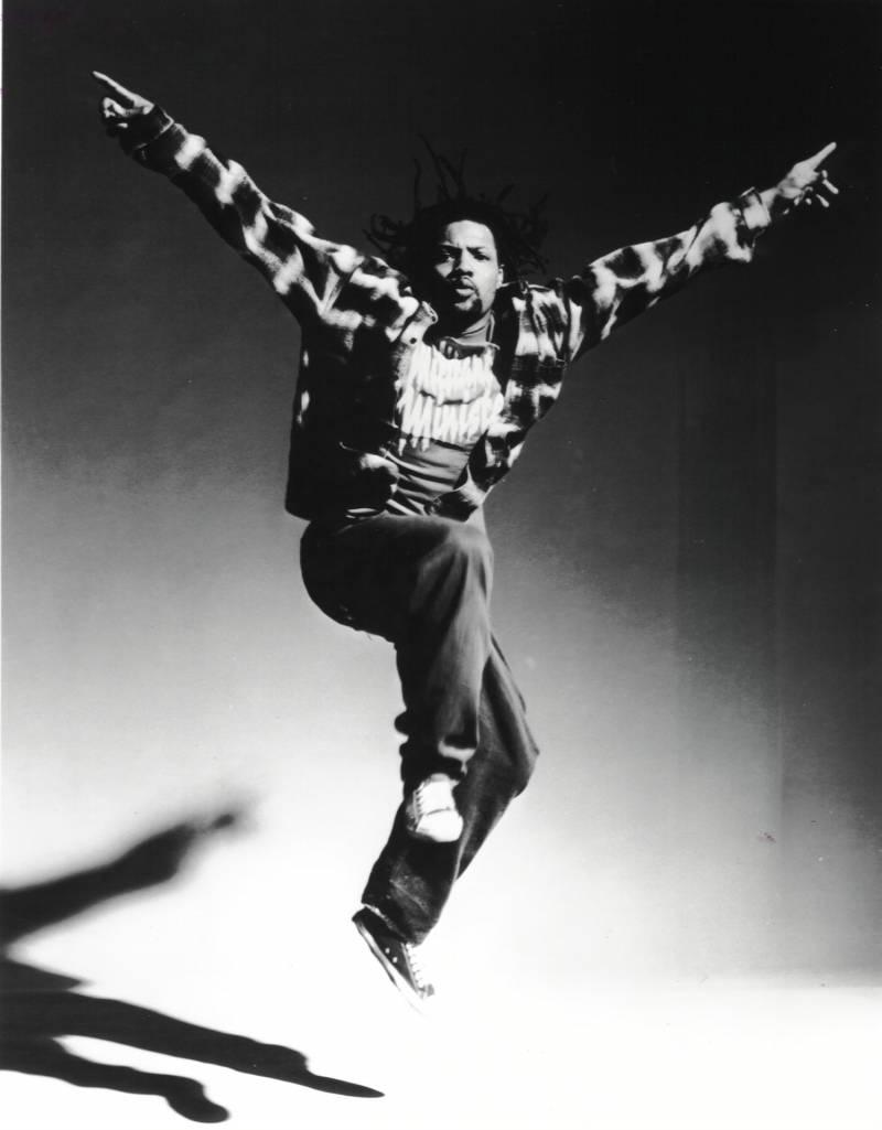 Black and white photo of Rennie Harris captured mid-jump.