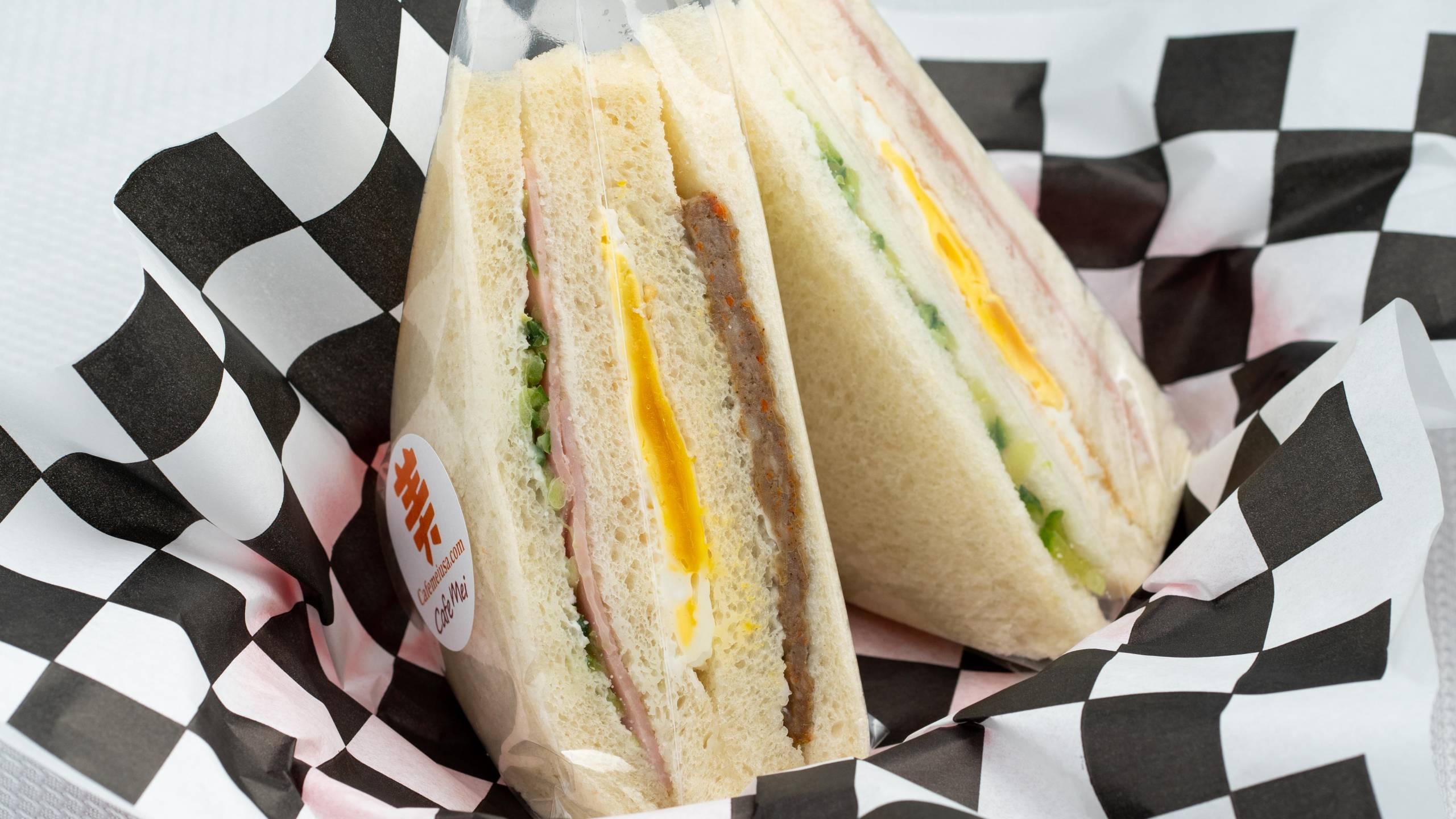 A Taiwanese breakfast sandwich wrapped in plastic.