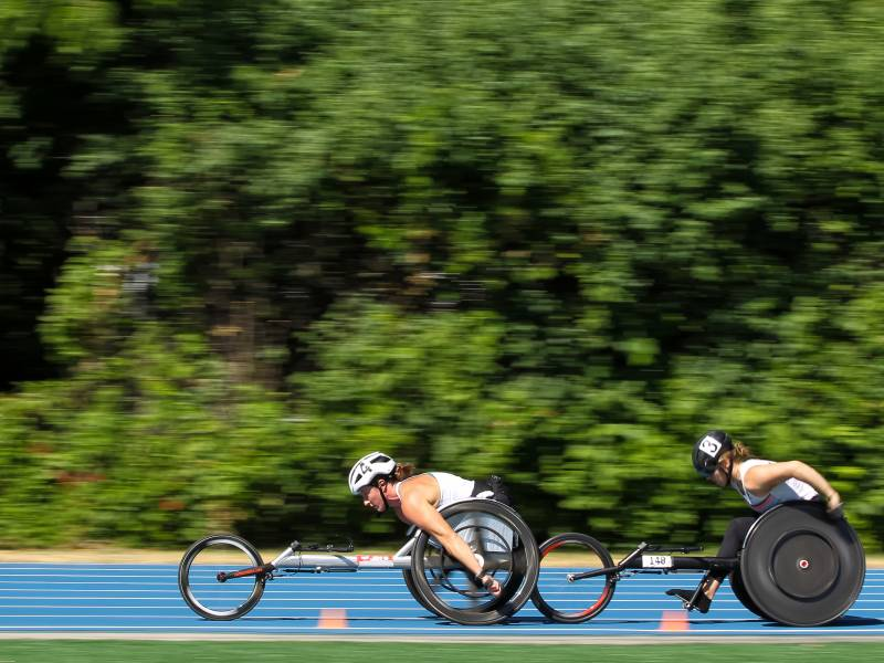 Tatyana McFadden, center, and Jenna Fesemyer of the United States compete in the Women's 5000 Meter Run T53/54 Wheelchair final during the 2021 U.S. Paralympic Trials at Breck High School on June 18, 2021 in Minneapolis, Minnesota.