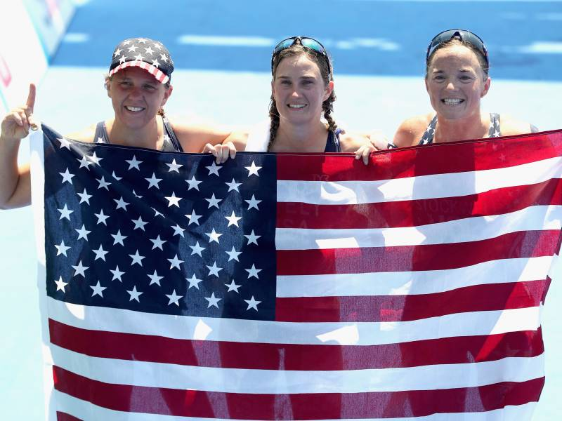 Hailey Danz (nee Danisewicz), Allysa Seely and Melissa Stockwell pose for photographers after sweeping the first three places in the women's triathlon PT2 at Fort Copacabana during the Rio 2016 Paralympic Games on Sept. 11, 2016, in Brazil.