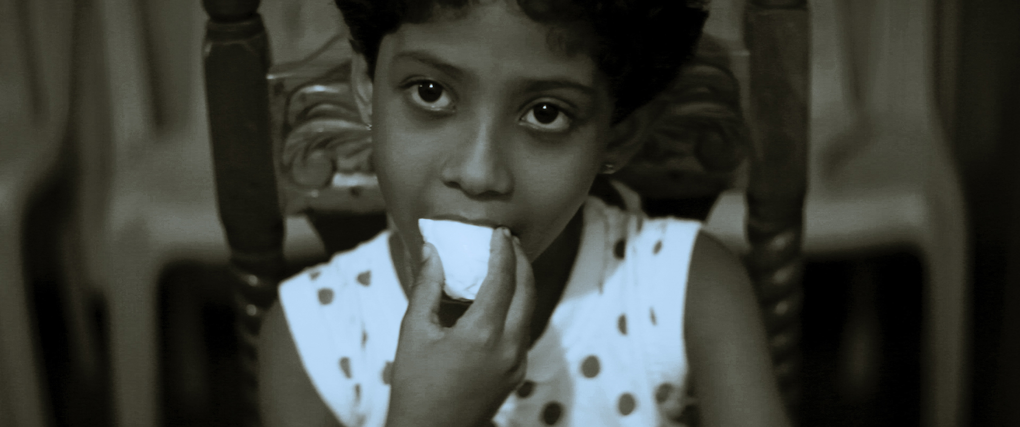 A child eats a piece of food.