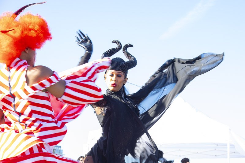 Dancers in elaborate costumes face each other.