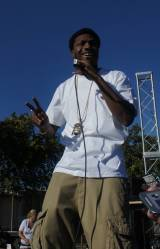 The Los Rakas medallion sits on Raka Duns white shirt as he performs at the Life Is Living Festival in West Oakland circa 2013)