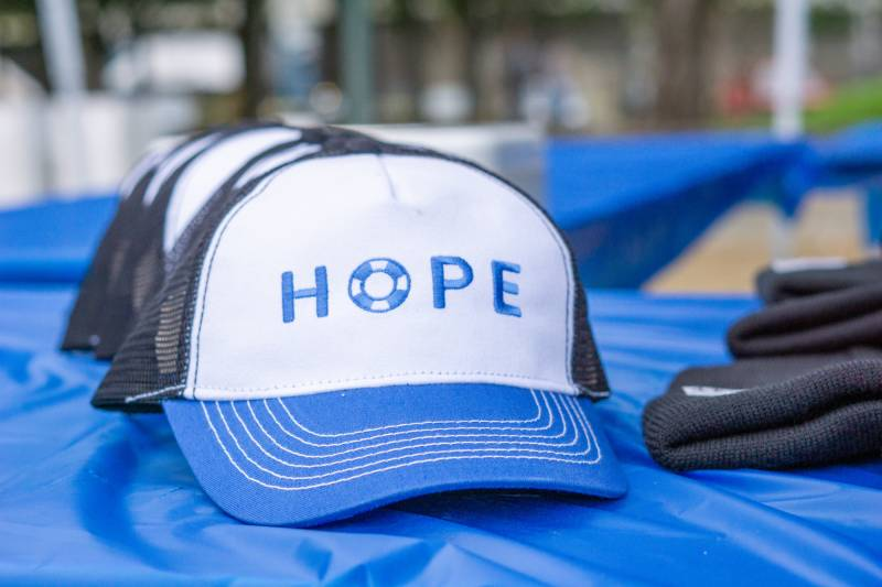 A hat that reads 'HOPE' sits on a table at a previous Out Of The Darkness event.