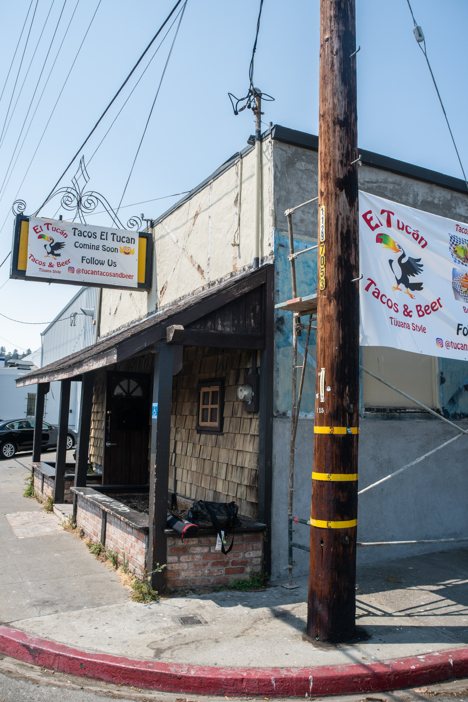 """Exterior of a restaurant with """"El Tucán Tacos and Beer"""" signage."""