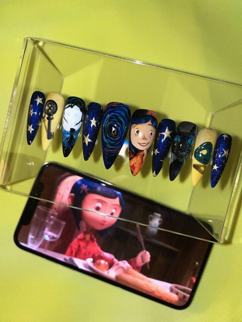 Press-on nails inspired by the cartoon film, Coraline.