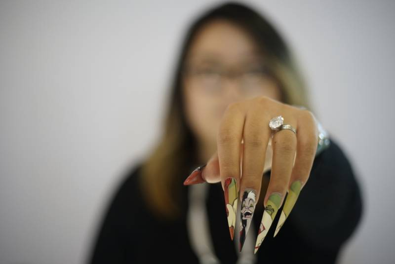 Pamper Nail Gallery owner Vivian Xue Rahey shows off her Cruella Deville inspired painted nails.