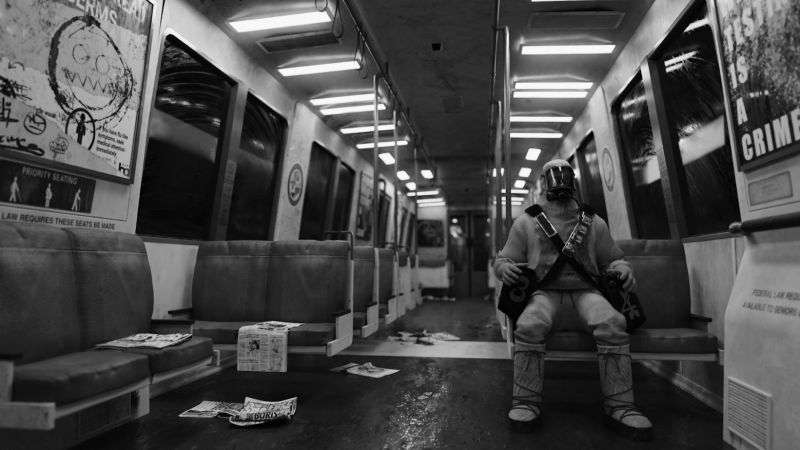 Black-and-white image of a man on a BART train.
