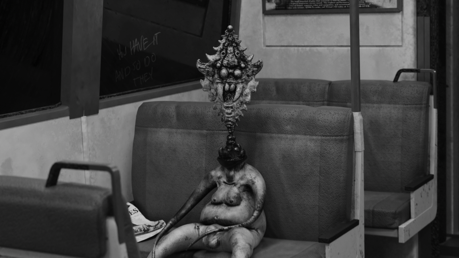 Black-and-white image of a scary creature on a BART seat.