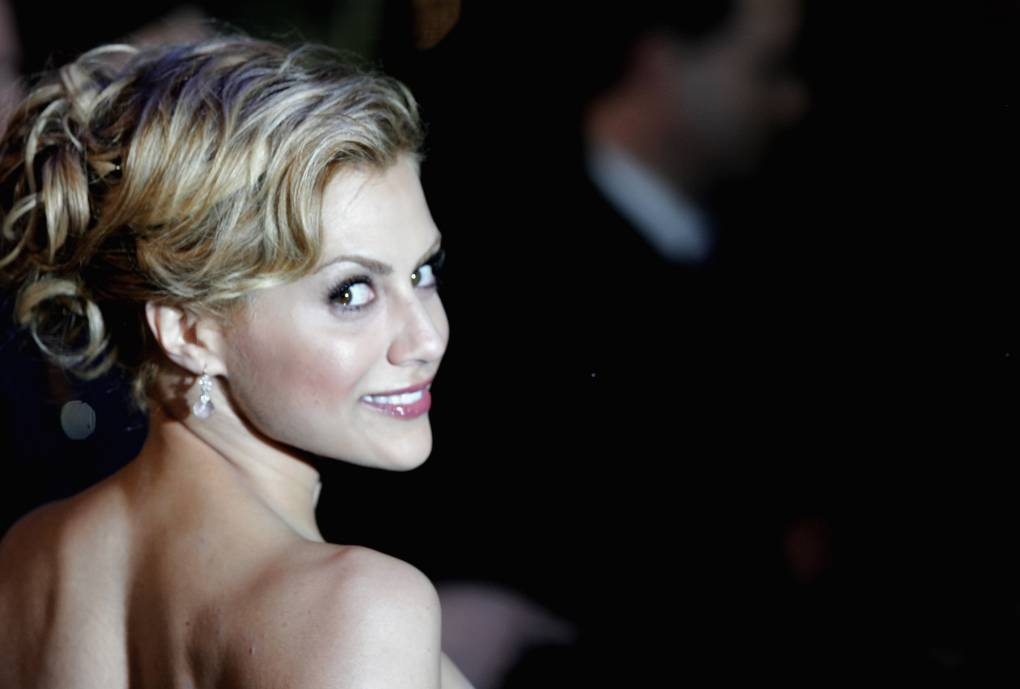 The actress, Brittany Murphy, glances over her shoulder and smiles for the camera.