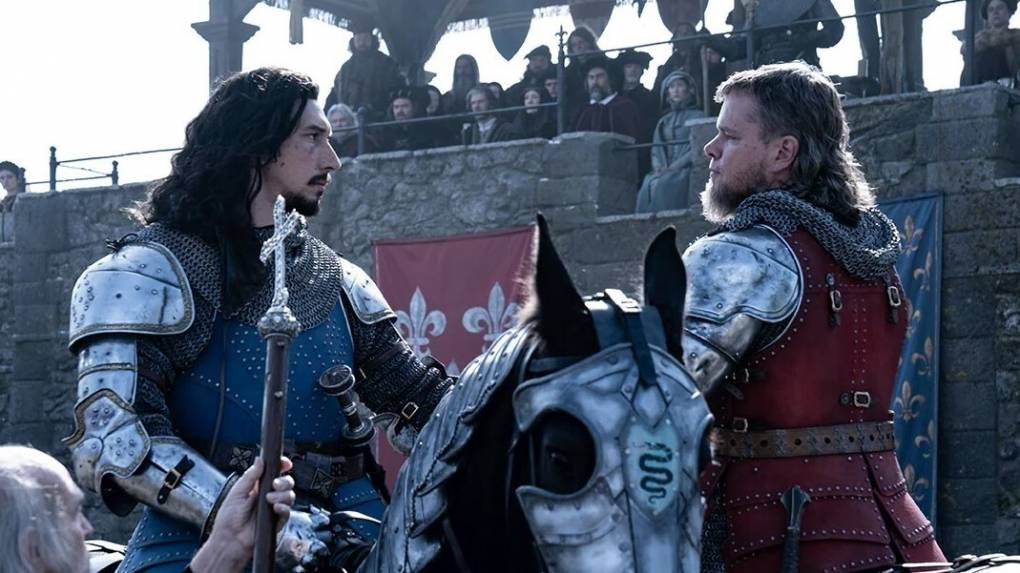 Two men, wearing armor and riding horses, face off as a crowd gathers atop a castle wall behind them.