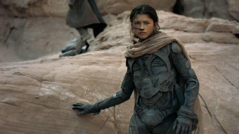 Woman against a rock.