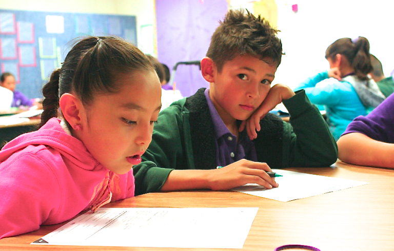 For Low-Income Kids, Is More Time in School the Answer?