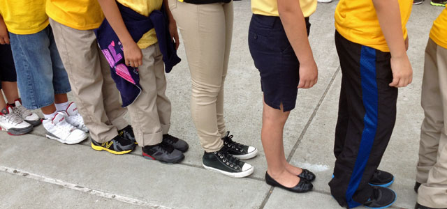 Encompass Academy students stand in a line as they practice moving between classrooms.