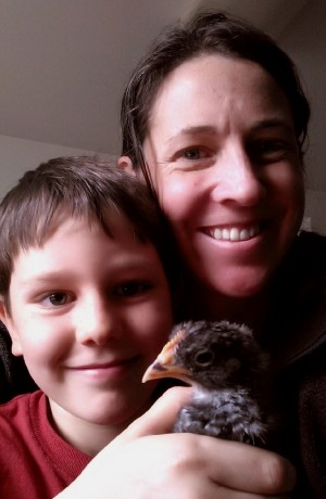 Ellen Jenkins, 8-year-old Nyles and their chick.