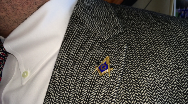 The discovery of this Freemasons pin helped students unlock the next phase of the Dolus game. (Courtesy of John Fallon)