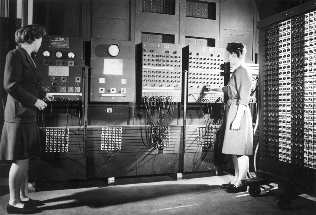 Jean Jennings (left) and Frances Bilas set up the ENIAC in 1946. Bilas is arranging the program settings on the Master Programmer. (Courtesy of University of Pennsylvania)