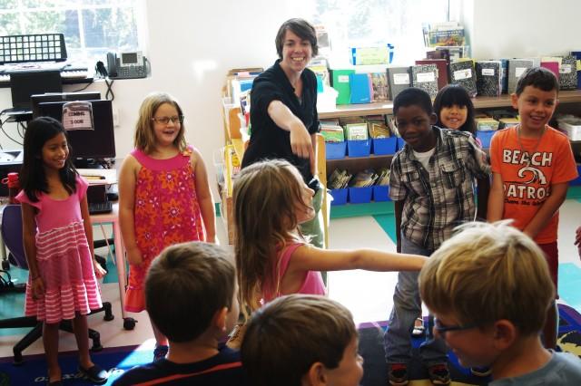 Second-grade teacher Amanda Siepiola points to Hannah Wiener during a game at Horace Mann Elementary in Washington, DC. (Gabrielle Emanuel/NPR)
