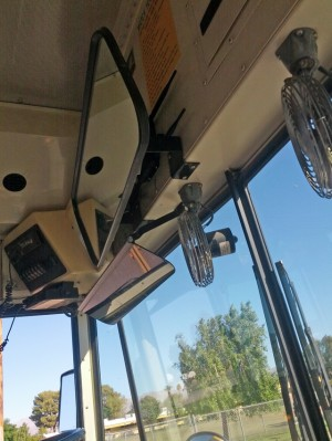 A Wi-Fi router is mounted behind the interior driver's mirror inside this Coachella Valley Unified School District bus. (Credit: Nichole Dobo, The Hechinger Report)