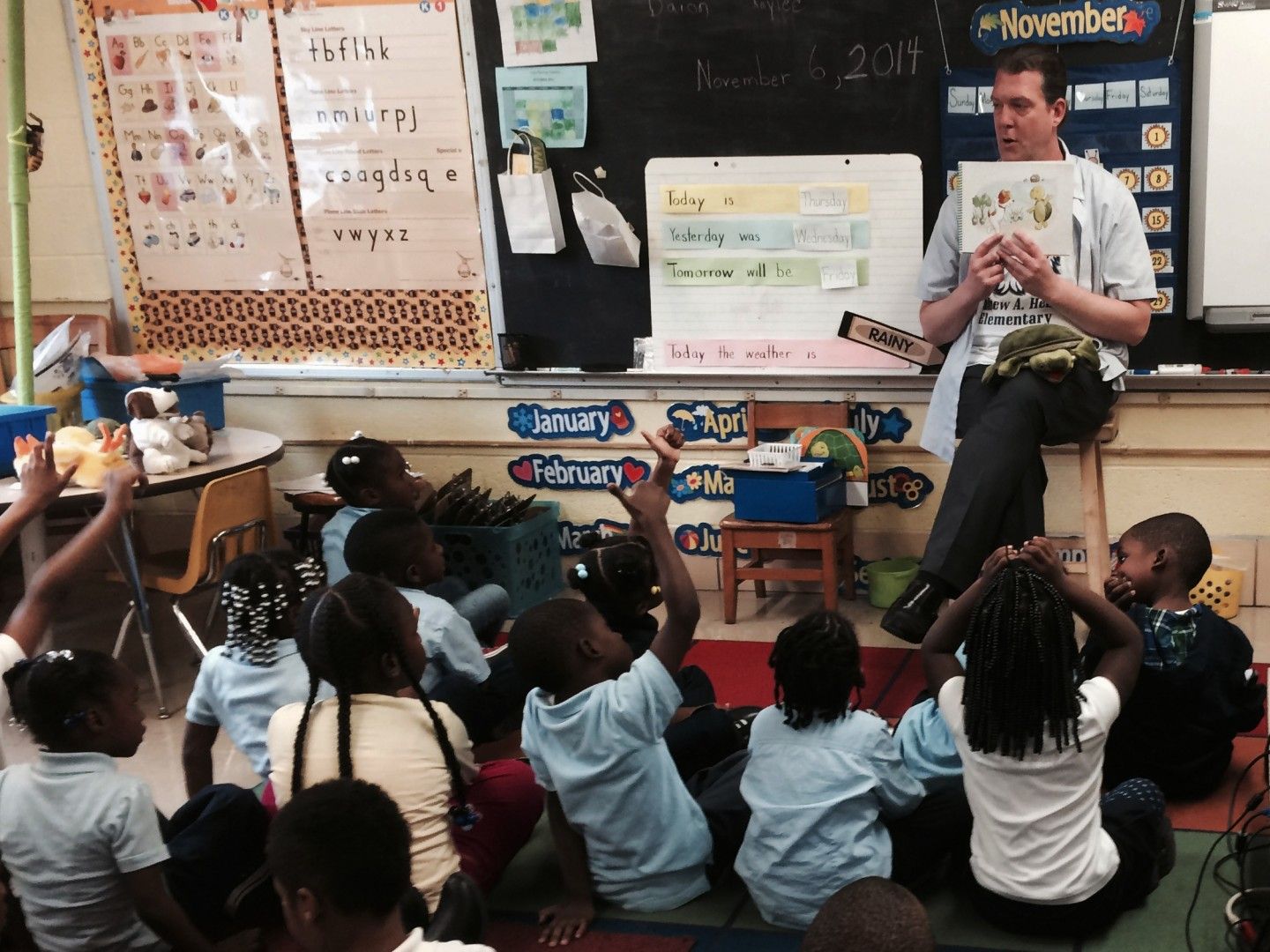 Thomas O'Donnell reads about Twiggle the Turtle to his kindergartners at Matthew Henson Elementary School in Baltimore. (Elissa Nadworny/NPR)